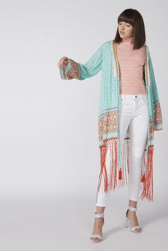 Printed Shrug with Long Flared Sleeves and Tassels
