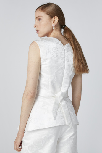ELLE Sleeveless Textured Top with Flower Applique Detail and Tie Ups