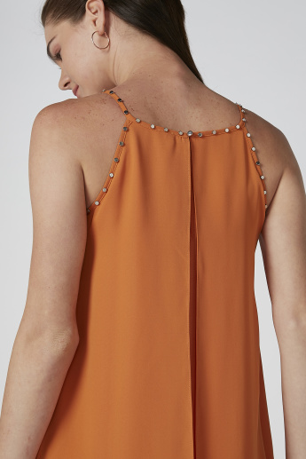 ELLE Solid Studded Detail Top with Asymmetric Hem and Straps
