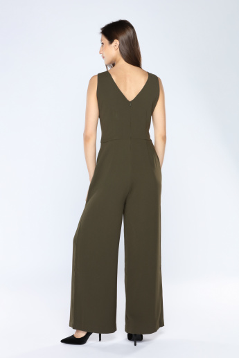 Iconic Studded Jumpsuit with V-Neck and Zip Closure