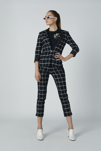 Iconic Chequered Cropped Pants with Ruffle Detail