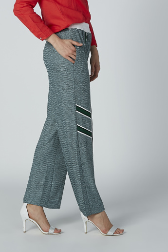 Iconic Printed Palazzo Pants with Tape and Pocket Detail
