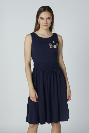 Iconic Sleeveless Skater Dress with Floral Applique Detail
