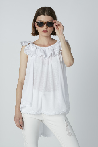 Iconic Solid Sleeveless Top with Schiffli Detail and High Low Hem