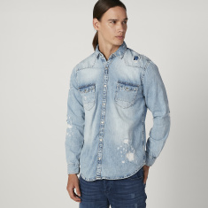 Iconic Distressed Denim Jacket with Buttoned Flap Pockets
