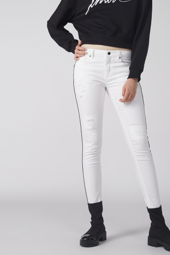 Distressed Jeans with Button Closure and Pocket Detail