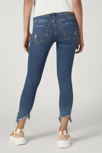 Skinny Fit Distresses Mid Waist Jeans with Frayed Grazers and Pockets