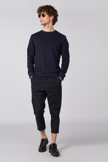 Cropped Pants with Button Closure and Pocket Detail