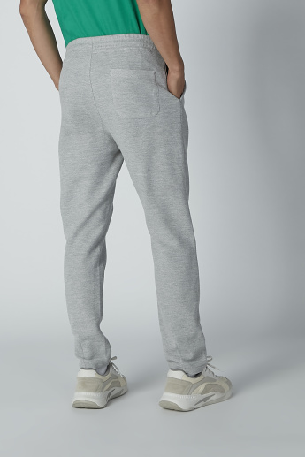 Textured Mid-Rise Trousers with Pocket Detail and Drawstring Closure