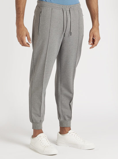 Solid Mid-Rise Jog Pants with Elasticated Waist and Zipper Pockets