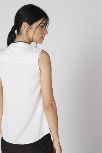 Mandarin Collar Sleeveless Top with Ruffle Detail