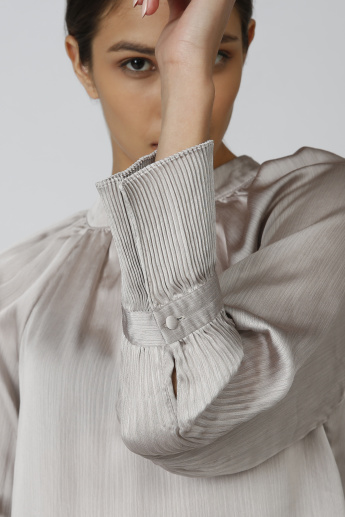 Sustainable Textured Top with High Neck and Pleat Detail Sleeves