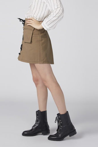 Textured Mini Skirt with Pocket Detail and Tie Ups