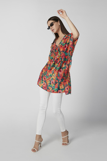 Sustainable Printed Top with Flared Sleeves and Tie Ups