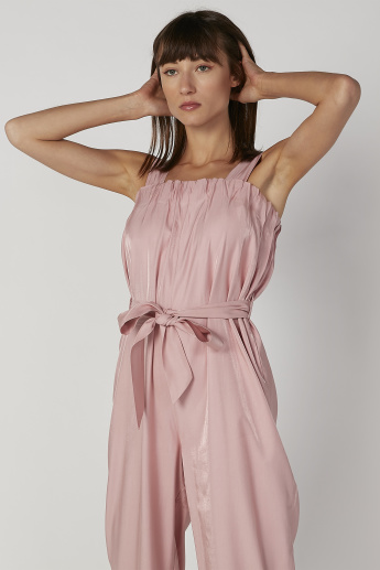 Plain Sleeveless Jumpsuit with Pocket Detail and Tie Ups